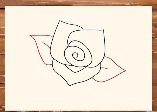 Как легко нарисовать розу - Нарисуйте по одному листику с каждой стороны цветка с небольшой жилкой по середине.